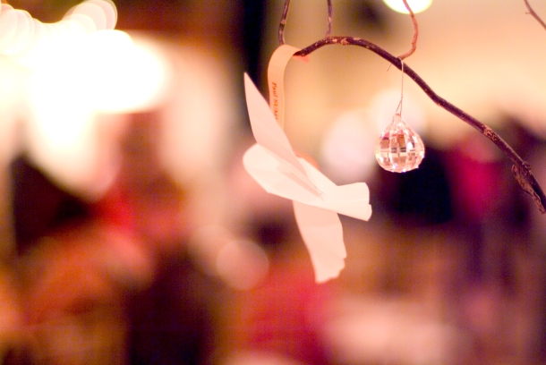 Place cards hang from the centerpieces creating whimsy.